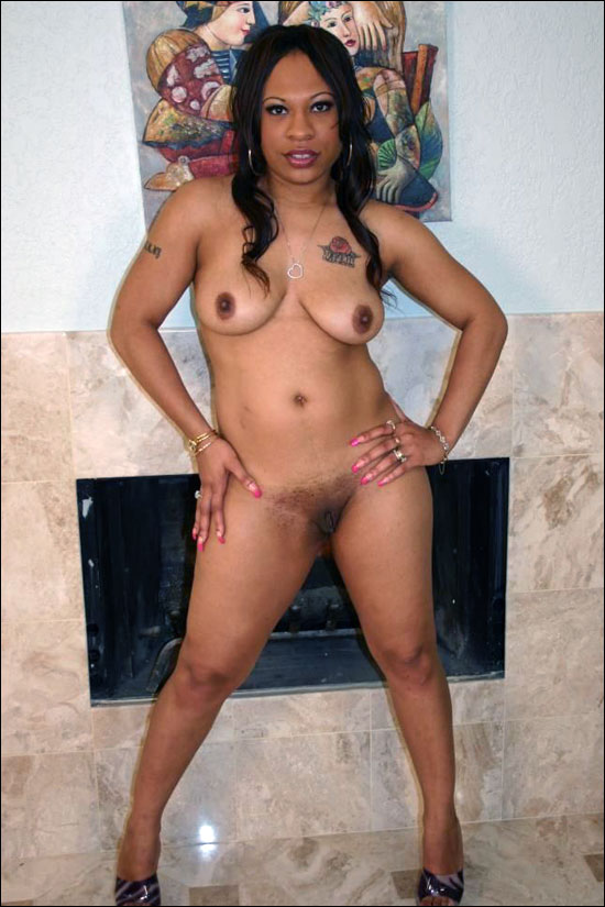 Gorgeous tattoed black chick slowly getting naked while posing and then showing off her naked sexy body for us all to enjoy