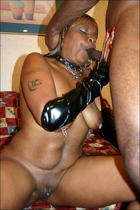 Black chick Suckable strips off her clothes and then she oils her hot body before she kneels down to suck on a huge cock over here